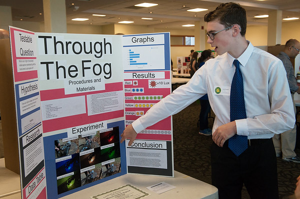 Caden Champagne, an eighth grader at Carthage Junior High School, talks about his experiments with headlights during Tuesday's annual Missouri Southern Regional Science Fair at MSSU.<br /> Globe   Roger Nomer