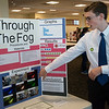 Caden Champagne, an eighth grader at Carthage Junior High School, talks about his experiments with headlights during Tuesday's annual Missouri Southern Regional Science Fair at MSSU.<br /> Globe | Roger Nomer