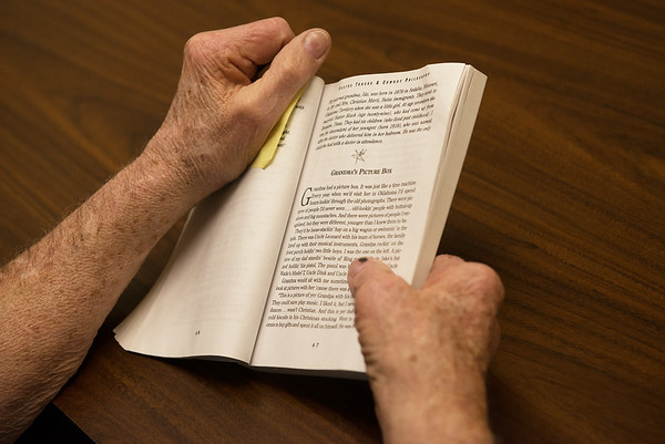 Grant Bell reads from a book by Baxter Black at Joplin NALA on Monday.<br /> Globe | Roger Nomer