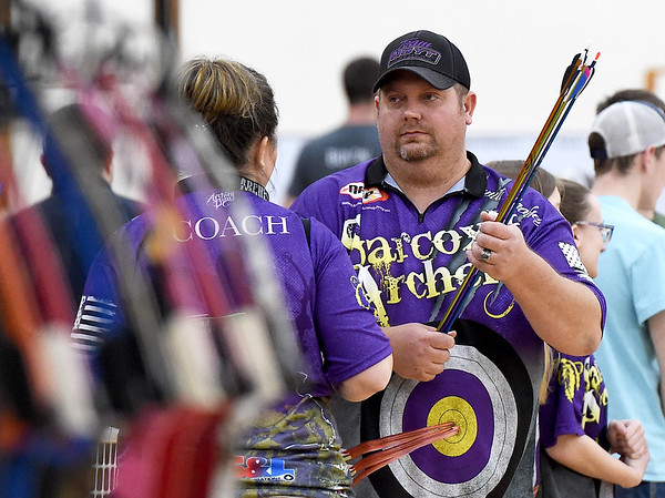 Sarcoxie coach David Woolsey, right, and his wife and assistant coach Kaycia Woolsey chat between rounds in the 3D competition of the Missouri National Archery in the Schools Program's State Qualifying Tournament on Saturday at Missouri Southern's Robert Ellis Young Gymnasium.<br /> Globe | Laurie Sisk