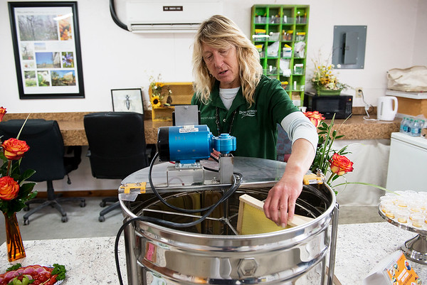 Dawn Wormington, horticulture supervisor for Downstream Casino and Resort, talks about the honey making process at Downstream's greenhouse on Thursday.<br /> Globe | Roger Nomer