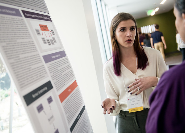Callie Torres, a second year student from Springfield, Ill., presents her research to a judge during Wednesday's research symposium at Kansas City University of Medicine and Biosciences Joplin.<br /> Globe | Roger Nomer