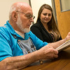Grant Bell reads with Grace Clouse, executive director of Joplin NALA, at Joplin NALA on Monday.<br /> Globe | Roger Nomer