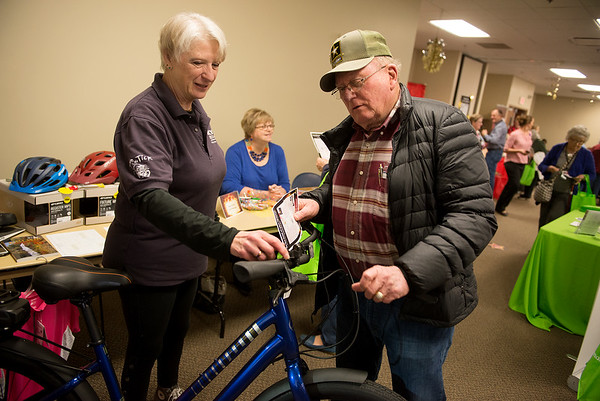 Debra Johnson, owner of Bicycle Specialist, talks with James Sparlin, Joplin, during Tuesday's Freeman Advantage Annual Health and Resource Fair at the Freeman Business Center. The event offered screenings, giveaways and presentations on health for area seniors.<br /> Globe | Roger Nomer