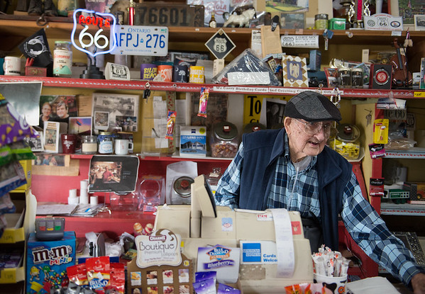 Forrest Nelson rings up a customer on Tuesday at the Old Riverton Store.<br /> Globe | Roger Nomer