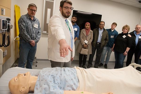 Matthew McAuliffe, a second year student at Kansas City University of Medicine and Biosciences Joplin from Saratoga Springs, NY, gives a tour of the school's simulation lab during Saturday's Accepted Students Day to welcome incoming students and their families.<br /> Globe   Roger Nomer