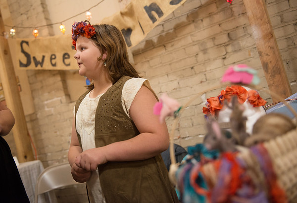 McKensey Teel, 10, Joplin, talks to customers about her hand-woven creations she had on sale at the Hip Handmade Market on Saturday at the Joplin Empire Market. The entrepreneur even wove her own display baskets and created the sign for her business called Sweet Springs.<br /> Globe | Roger Nomer