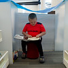 Colton Staples, 7, Joplin, reads in a fort made between bookshelves during Fort Building Night at the Joplin Public Library on Friday.<br /> Globe | Roger Nomer