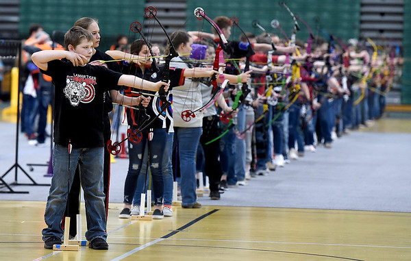 Students compete in a Bullseye round of the Missouri National Archery in the Schools Program's State Qualifying Tournament on Saturday at Leggett & Platt.<br /> Globe   Laurie Sisk