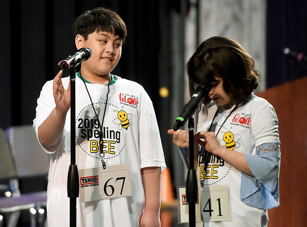 From the left: Nevada Truman Elementary fifth grader Jethro Adriel A. Soldium smiles at McKinley Elementary fifth grader Moira Morris as they square off for the championship of the 42nd Annual Joplin Globe Spelling Bee on Monday at Thomas Jefferson Independent Day School.<br /> Globe | Laurie Sisk