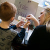 Americorps reading coach Misty Jolliffe works with EJ Patterson, first grade, on a reading exercise at Purdy Elementary School on Wednesday.<br /> Globe | Roger Nomer