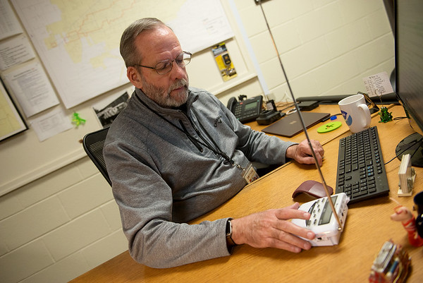 Keith Stammer, emergency management director for Joplin, operates a weather radio in his office on Monday.<br /> Globe | Roger Nomer