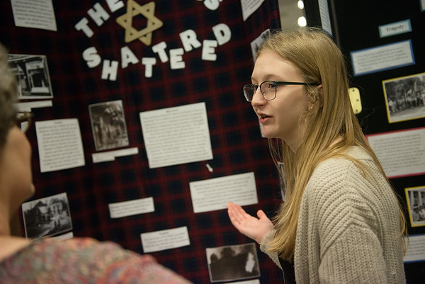Bella Brooks, an eighth grader at Nevada Middle School, gives her presentation on Herschel Grynszpan on Friday during History Day at Missouri Southern. <br /> Globe | Roger Nomer