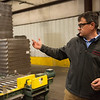 Greg Powell, Columbus plant manager for TAMKO, talks about the manufacturing process of TAMKO's Flash-N-Wrap in Columbus on Feb. 28.<br /> Globe | Roger Nomer