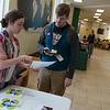 Haley Henry, a Missouri Southern senior from Monett, talks to Patrick Corn, a MSSU senior from Baxter Springs, about joining the national Be the Match bone marrow donor registry during an infromation event held by the MSSU chapter of Love Your Melon on Wednesday at MSSU. <br /> Globe | Roger Nomer