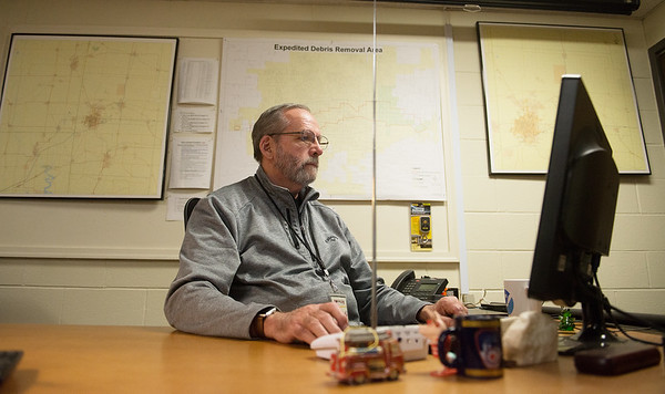 Keith Stammer, emergency management director for Joplin, monitors the weather in his office on Monday.<br /> Globe   Roger Nomer
