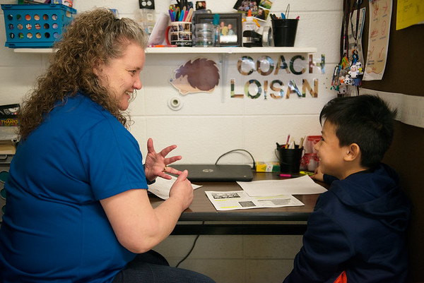 Americorps reading coach Loisana Smith works with Jordyn Deleon, fourth grade, on a reading exercise at Purdy Elementary School on Wednesday.<br /> Globe | Roger Nomer
