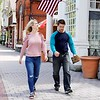BEN GARVER — THE BERKSHIRE EAGLE<br /> A couple walks past the shops in downtown Stockbridge.