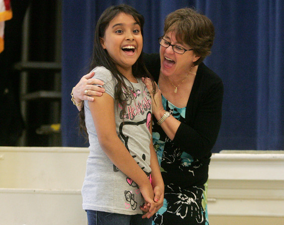 Globe/Roger Nomer<br /> Karen Alvarado, a fourth grader at West Central Elementary, and her teacher Susie Bradley react in surprise as Clifford the Big Red Dog brings her a check for $1,200 for being selected for the Scholastic READ 180 All-Star Award on Monday.  Alvarado didn't speak English when she moved to U.S. from Mexico a year and a half ago.  After a year of the READ 180 instruction, she now reads at a fifth-grade level.  She was one of only three students selected in the country for the award.