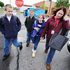 Globe/T. Rob Brown<br /> Sherri Petry, right, walks three of her children, from left, Sam, 11, Timothy, 10, and Lilli, 9, to the family vehicle after school Friday afternoon, May 3, 2013, before heading to Carl Junction Jr. High to pick up their older brother, Jonathan, 13.