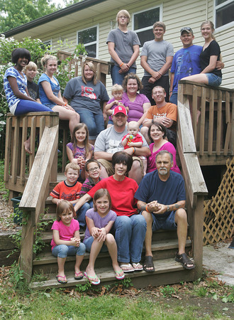 Globe/Roger Nomer<br /> The Simpson family includes (from top left) Dillon Simpson, son, 15, Gabe Martin, grandson, 16, Zac Martin, grandson, 17, Zaeh Martin, granddaughter, 13, (second row from top) Faith Simpson, daughter, 12, Kyle Simpson, son, 11, Jaci Simpson, daughter, 15, Kalli Simpson, daughter, 17, Maranda Spry, daughter, Mia Winkler, 2, granddaughter, Justin Winkler, son-in-law, (third row from top) Madi Brown, granddaughter, 10, Nathan Brown, son-in-law, Logan Brown, grandson, 10 months, Darci Brown, daughter, (last row) Isaac Simpson, son, 4, Justus Brown, grandson, 6, Syndi Brown, granddaughter, 4, Maci Brown, granddaughter, 8, Sandi and Mike Simpson.
