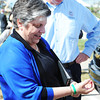 Globe/T. Rob Brown<br /> Secretary of Homeland Security Janet Napolitano puts on a Joplin tornado anniversary bracelet before the start of the second anniversary events Wednesday evening, May 22, 2013, at Cunningham Park.