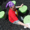 Globe/Roger Nomer<br /> Jessica Morton, manager of the Nevada McDonalds, cleans playground equipment as KaBOOM! playground prepares to open at Community Support Services on Friday.