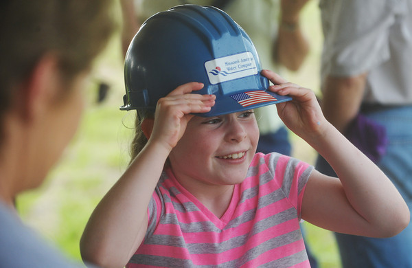Globe/Roger Nomer<br /> Ava Gould, a third grader at St. Mary's Elementary, came prepared for Thursday's groundbreaking of the school and church.