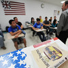 "Globe/T. Rob Brown<br /> Jason Navarro, Wheaton High School social studies teacher, leads, but not from the patriotic podium that holds his ""American Realities"" textbook, the discussion in his History 107 class on modern history from 1877 to present as they discuss the history of computers Wednesday afternoon, May 1, 2013. Navarro was recently named Teacher of the Year by the Missouri State History Day. This class is dual credit with Crowder College."