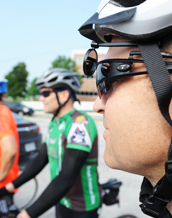 "Globe/T. Rob Brown<br /> Aaron Brown of Joplin, right, cheks his rearview mirror attachment Saturday morning, May 18, 2013, in the parking lot of MSSU's Fred G. Hughes Stadium prior to JoMo Nola, ""riding to bring families home."""