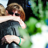Globe/T. Rob Brown<br /> Pamela Praytor (facing camera) gets an emotional hug from a friend after placing a wreath (at right) during the second anniversary events of the Joplin tornado Wednesday evening, May 22, 2013, at Cunningham Park. Praytor's son Christopher Lucas died during the 2011 tornado while saving lives at Pizza Hut.