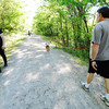 """Globe/T. Rob Brown<br /> Bob McDermid, right, of Joplin, walks with his Australian shepherd Bailey as other walkers travel along the Frisco Trail in the Royal Heights area Saturday afternoon, May 13, 2013. """"I suspect this is the most widely used park in Joplin,"""" McDermid said of the trail. """"I'm out here every day. In the afternoon when we walk, there's usually 35 to 40 regulars. Some we know by name or by the dogs they're walking."""""""