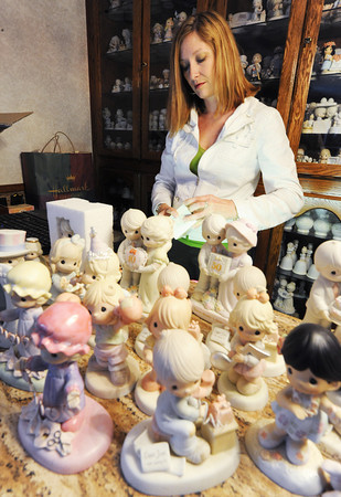 Globe/T. Rob Brown<br /> Crystal Webster of Springfield, Breast Cancer Foundation of the Ozarks, boxes up a Precious Moments figurine from an extensive collection donated from a home in Granby Wednesday morning, May 8, 2013.