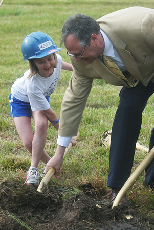 Globe/Roger Nomer<br /> Randall Milbrath, an architect with RDG Planning and Design, helps Hannah Hilsabeck, a fifth grader at St. Mary's Elementary, with a shovel of dirt during Thursday's groundbreaking.