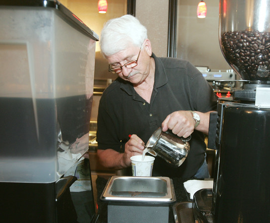 Globe/Roger Nomer<br /> Danny Anderson, owner of the Streetcar Station Coffee House, prepares a hot drink on Thursday afternoon.