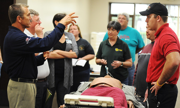 Globe/T. Rob Brown<br /> Jeff Case, left, TEEX (Texas Engineering Extension Services) instructor for EMS response to weapons of mass destruction, trains a group of Southwest Missouri medical and emergency personnel Wednesday afternoon, May 15, 2013, at the Freeman Business Center in Joplin. The training uses sophisticated dummies to simulate medical response scenarios. Andrew Leach, Aurora firefighter/EMT, is at right.