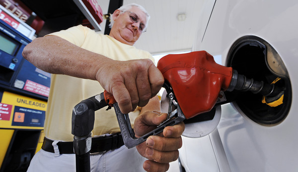 Globe/T. Rob Brown<br /> Dave Walden of Columbus, Kan., fills up his pickup truck Wednesday morning, May 22, 2013, at the Casey's General Store on North Maiden Lane in Joplin.