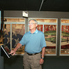 Globe/Roger Nomer<br /> Jim Hall, president of the Baxter Springs Historical Society, demonstrates an interactive exhibit on baseball at the museum on Thursday.