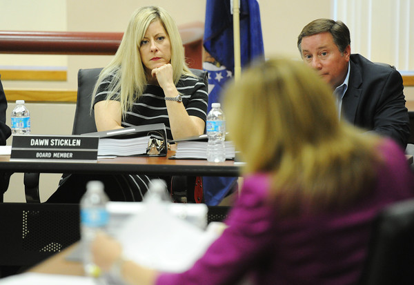 """Globe/T. Rob Brown<br /> Joplin School District Board of Education member Dawn Sticklen listens as sexually explicit scenes are read from Randy Turner's book, """"No Child Left Alive"""" during Turner's hearing at Joplin School District's administration offices Thursday morning, May 23, 2013."""