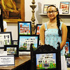 Globe/T. Rob Brown<br /> Sisters Conalee Churchwell, 13, left, and Cydney Churchwell, 16, both of Joplin, stand next to art they created of their home, the historic William Picher home in Joplin during a visit to the display of their and other students' work in the Post Memorial Art Reference Library in the Joplin Public Library Wednesday afternoon, May 1, 2013. The students are part of Local Color located in the Gryphon Building.