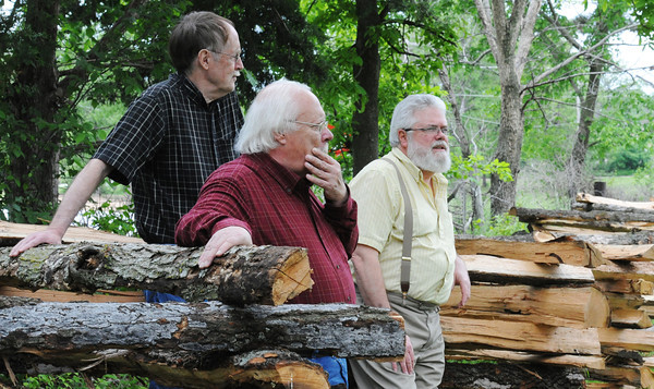 Globe/T. Rob Brown<br /> (from left) Larry Wood and Steve Weldon, both of Joplin, and Steve Cottrell of Carthage lean up against a Civil War era-style fence as they ponder future plans for the Rader Farm Thursday afternoon, May 16, 2013.