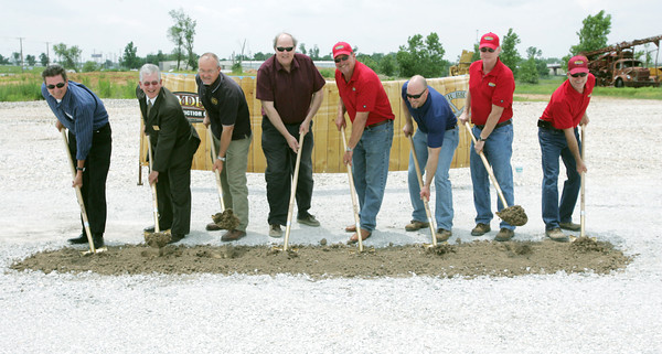 Globe/Roger Nomer <br /> (from left) Curt Crossland,  president of Midwest division at Crossland Construction, Tim Woodall, vice president of lending at Pinacle Bank, Rick Massey, president and CEO at Total Electronic Contracting, Kyle Denham, president of PLJBD Architects, Jim Zerkel, Jr., president of Snyder Construction, Joey Hiers, Crossland project manager, Rusty Snyder, vice president of operations at Snyder Construction and Russ Zerkel, vice president and safety director at Snyder, help break ground on Snyder Construction's new office building on Tuesday at 2120 Davis Boulevard.  The previous building on Davis Boulevard was destroyed in the May 22, 2011, tornado.