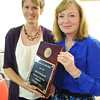 Globe/T. Rob Brown<br /> Joplin Globe's CNHI Reporter of the Year Andra Stefanoni receives her plaque from Donna Barrett.