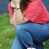 Globe/T. Rob Brown<br /> Linda K. Emmert of Duenweg drops to her knee and cries during the moment of silence second anniversary event of the Joplin tornado Wednesday evening, May 22, 2013, at Cunningham Park.
