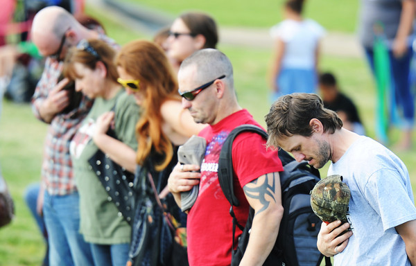 Globe/T. Rob Brown<br /> Members of the crowd participate in the moment of silence during the second anniversary events of the Joplin tornado Wednesday evening, May 22, 2013, at Cunningham Park.