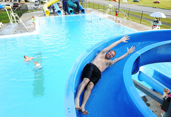 Globe/T. Rob Brown<br /> Jerimy Timi of Joplin takes advantage of the open pool time Wednesday evening, May 22, 2013, at Cunningham Pool, as part of the tornado anniversary events. Joplin city pools officially open this weekend.