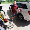 Globe/T. Rob Brown<br /> David Fort of Carl Junction fills up his vehicle's tank Wednesday morning, May 22, 2013, at the Casey's General Store on North Maiden Lane in Joplin.