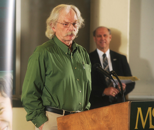 Globe/Roger Nomer<br /> Former Joplin High teacher Charles Parker accepts his award during Monday's 2013 All-Area Academic Excellence Team banquet at Missouri Southern.