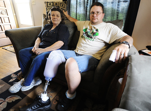 Globe/T. Rob Brown<br /> Delbert and wife Jackie McGuirk in their temporary home in Carl Junction Friday, May 17, 2013.