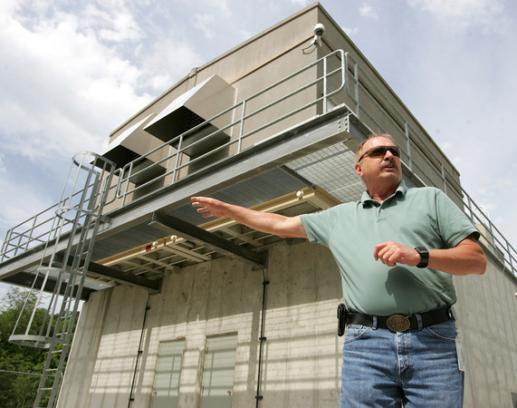 Globe/Roger Nomer<br /> Rich Kiwala, operations supervisor for production for Missouri American Water, gives a tour of a intake station along Shoal Creek on Wednesday morning.